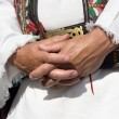 Hands of man in the garb — Stock Photo