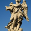 Rome - Angel with the superscription from Angels bridge - Stock Photo