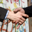 Hands of businessman and homeless — Stock Photo #10891304