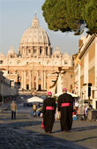 Rome - monsignore and st. Peter s basilica — Stock Photo