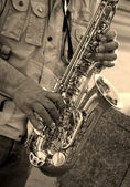 Hands of saxophone player — Stock Photo