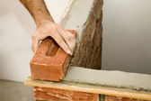 Hand of bricklayer at work — Stock Photo