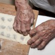 Hands of grandmother at backing — Stock Photo