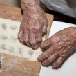 Hands of grandmother at backing - Stock Photo