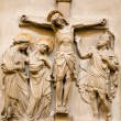 Vienna - relief Christ on the cross and hl. John and hl. Mary from the Dominicans church - Stock Photo