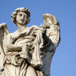 Rom - Angel with the whips - Ponte Sant'Angelo - Angels bridge - designed by Bernini - Stock Photo