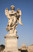 Rome - Ponte Sant'Angelo - Angels bridge - Angel with the thorn crown and cupola of Peter s basilica — Stock Photo