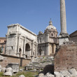 Rome - forum romanum - the arch of Triumph of Septimus Severus and st. Lucke chruch — Stock Photo #11110164