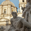 Stock Photo: Rome - PiazzNavonin morning and Fontandei Fiumi by Bernini and SantAgnese in Agone church