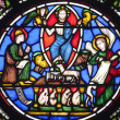 Paris - windowpane from Saint Denis gothic church - Jesus and four evangelists — Stock Photo #11110281