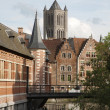 Gent - tower of st. Nicholas church and canal with the typical brick houses. — Stock Photo