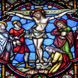 BRUSSELS - JUNE 22: Crucifixion from windowpane in st. Michael s gothic cathedral on June 22, 2012 in Brussels. — Stock Photo #12114080