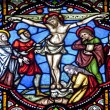 BRUSSELS - JUNE 22: Crucifixion from windowpane in st. Michael s gothic cathedral on June 22, 2012 in Brussels. — Stock Photo