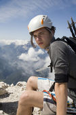 Mountaineer on the summit of Jalovec peak in Julian alps - Slovenia — Stock Photo