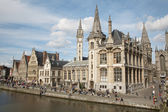 GENT - JUNE 23: Post palace and typical old houses and west facade of post palace with the canal in evening light from Graselei street on June 24, 2012 in Gent, Belgium. — Stock Photo