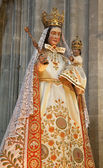 GENT - JUNE 23: Virgin Mary statue in the needlework garments from Notre Dame du Sablon church on June 23, 2012 in Gent, Belgium. — Stock Photo