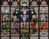 BRUSSELS - JUNE 22: Crucifixion from windowpane in gothic church Notre Dame du Sablon on June 22, 2012 in Brussels. — Stock Photo
