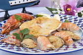 Scallops baked with mixed shellfish — Stock Photo