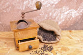 Antique coffee grinders and pepper — Stock Photo