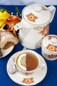 Tea with lemon croissant — Stock Photo