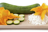 Zucchini with squash blossoms and rice — Stock Photo