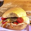 Porchetta sandwich with lettuce and tomatoes — Stock Photo
