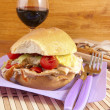 Porchetta sandwich with lettuce and tomatoes — Stock Photo #11850733