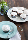 Chocolate cupcakes with cream frosting — Stok fotoğraf