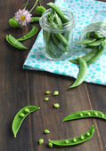 Snow peas pods in jar — Stock Photo