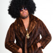 Hip hop urban black man retro afro hair wearing fur coat and bling bling isolated on white. Looking confident. Cool guy. Studio shot. — Stock Photo #11227844