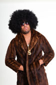 Hip hop urban black man retro afro hair wearing fur coat and bling bling isolated on white. Looking confident. Cool guy. Studio shot. — Stock Photo