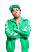 Hip hop urban black man wearing old school green suit and cap isolated on white. Looking confident. Cool guy. Studio shot. — Stock Photo