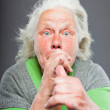 Senior woman white grey hair with expressive emotional face and hands. Studio shot isolated on grey background. — Stock Photo #11240688