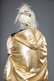 Cool senior woman wearing golden jacket. Long grey hair. Studio shot. Isolated. — Stock Photo