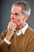 Expressive good looking senior man against grey wall. Funny and characteristic. Well dressed. Studio shot. — Stock Photo