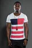 Cool urban stylish black american man. Fashion studio portrait isolated on grey background. — Stock Photo