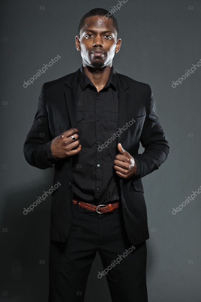 Cool black american man in dark suit. Studio fashion shot isolated on grey background. — Stock Photo #11644952