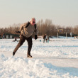 Dutch winter landscape with senior skater on frozen lake. Blue clear sky. Retired man. — Stock Photo #11650963