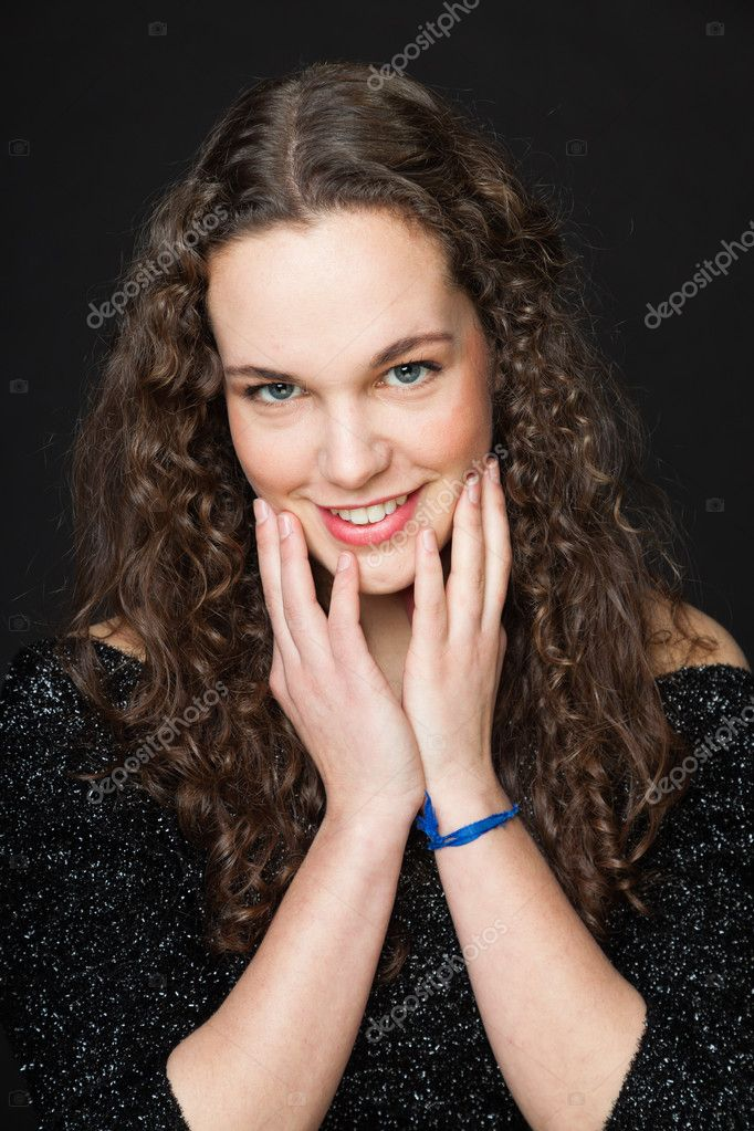 smiling pretty girl with long brown curly hair fashion