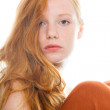 Pretty girl with long red hair wearing black shirt and brown dress. Fashion studio shot isolated on white background. - Stock Photo