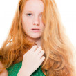 Pretty girl with long red hair wearing green shirt. Natural beauty. Fashion studio shot isolated on white background. — Stock Photo #11742660