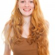 Happy smiling pretty girl with long red hair wearing brown shirt. Fashion studio shot isolated on white background. — Stock Photo #11742664