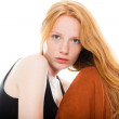 Pretty girl with long red hair wearing black shirt and brown dress. Fashion studio shot isolated on white background. — Stock Photo #11742674