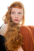 Pretty girl with long red hair wearing black shirt and brown dress. Fashion studio shot isolated on white background. — Stock Photo