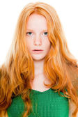 Pretty girl with long red hair wearing green shirt. Natural beauty. Fashion studio shot isolated on white background. — Stock Photo
