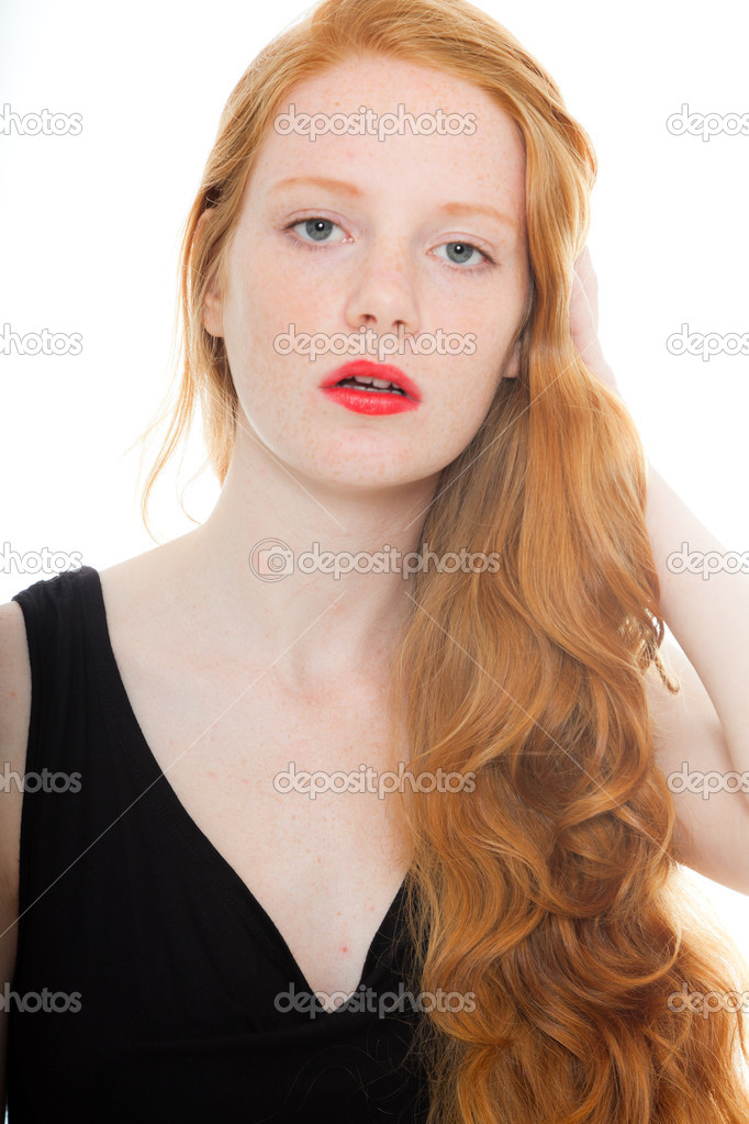 Pretty girl with long red hair and lipstick wearing black shirt. Fashion studio shot isolated on white background. — Stock Photo #11742676