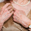 Closeup of hands of senior woman wearing a watch and ring. Studio shot. — Стоковое фото #11898410