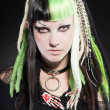 Cyber punk girl with green blond hair and red eyes isolated on black background. Expressive face. Studio shot. - Stock Photo