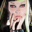 Cyber punk girl with green blond hair and red eyes isolated on black background. Expressive face. Studio shot. — Stock Photo