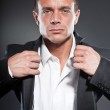 Good looking business man blue eyes and short blond hair. Tough guy. Wearing white shirt and black jacket. — Stock Photo #12389309